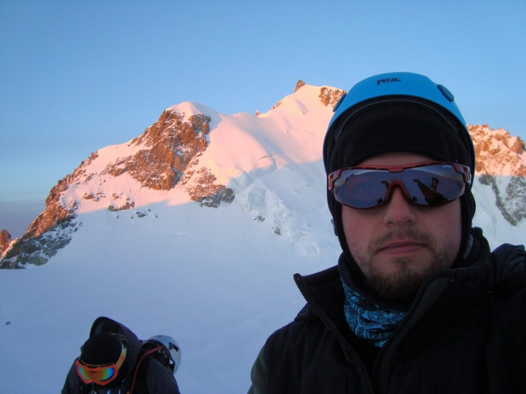 While summiting Mont Blanc on the Cosmiques route, with Mont Blanc du Tacul in the background.